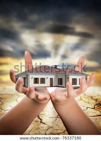 House sitting on hand sunrise in background - stock photo