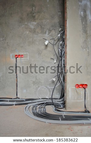 House under construction and repair at home. Electricity. Vertical. - stock photo