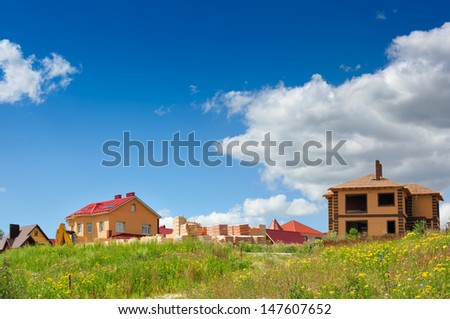 house under construction on the background of sky - stock photo