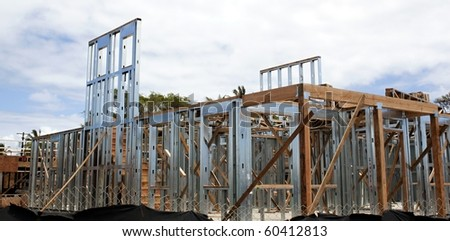 house under construction using steel frames - stock photo