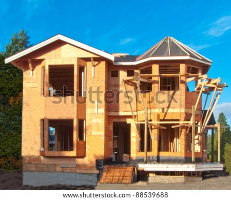 House under construction with dark blue sky as a background.