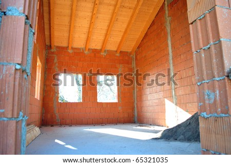 house under construction with red brick - stock photo