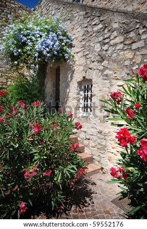 House wall and window with Flowers in france - stock photo