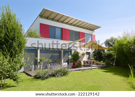 House with beautiful garden - stock photo