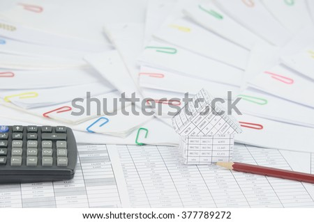 House with brown pencil and calculator on finance account have step of document with colorful paperclip place curve as background.