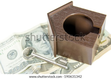 House with Dollars Banknote  and house key over white background - stock photo