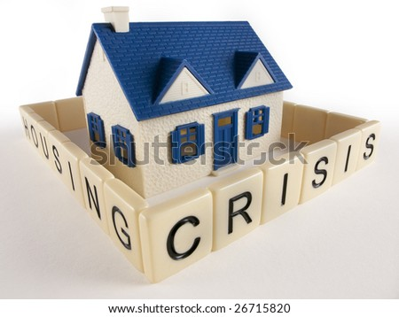 House with encircling Housing Crisis letter Fence - stock photo