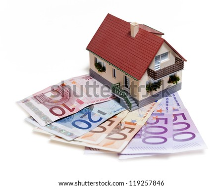 House with Euro banknotes over white background - stock photo