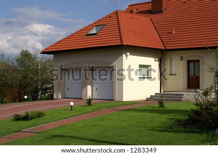 House with garage - stock photo