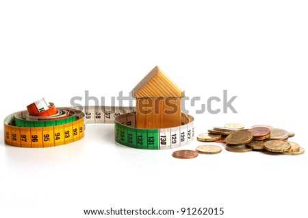 House  with measuring tape expressing the raise of prices - stock photo