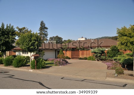 House with nice  landscaping and driveway, mailbox - stock photo