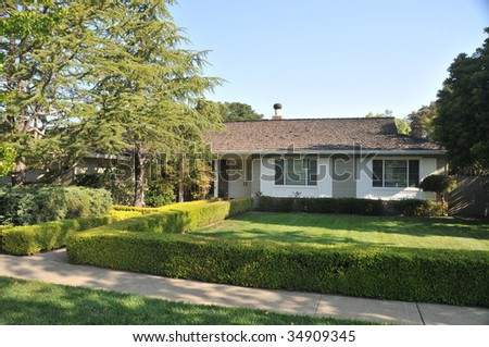 House with nice  landscaping including grass and shrubs - stock photo