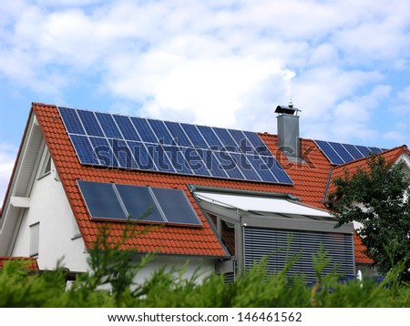 House with solar cells - stock photo