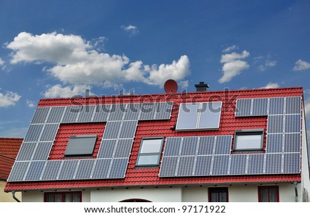 house with solar panels on roof. - stock photo