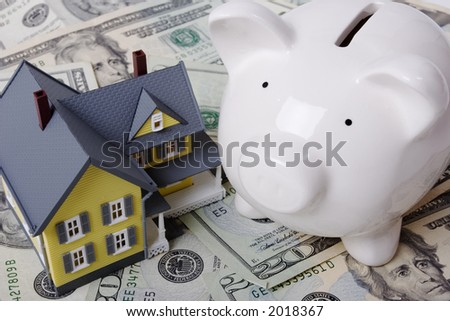 House with twenty dollar bills background and piggy bank - stock photo