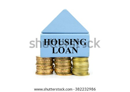 House Wooden Block and stacked of Coins with Housing Loan written - stock photo