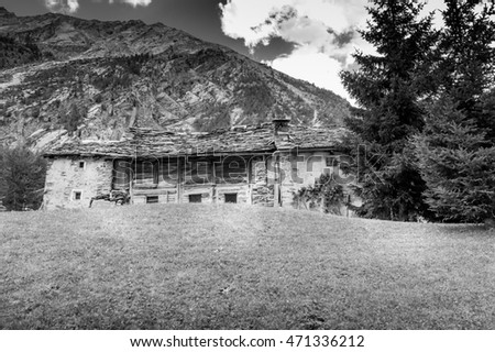 House, wooden chalets in the mountains, chalets old house in the Alps