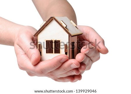 House Wooden in both hands - isolated on white background - stock photo
