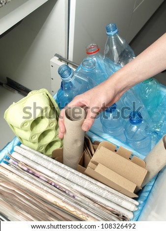 Household orders, plastic and paper garbage's segregation - stock photo