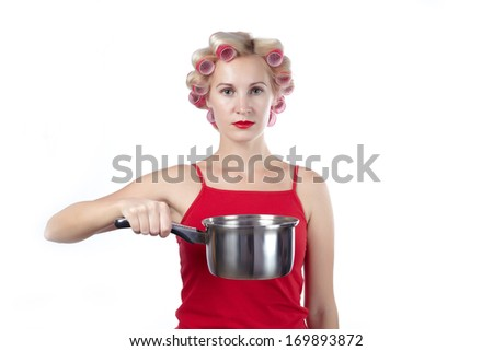 Household woman in red topic and rollers with pan against white background - stock photo