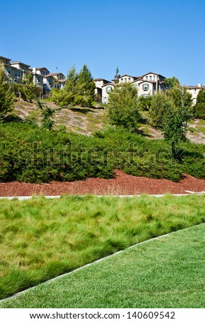 Houses along a ridge with landscaping in foreground in San Jose, California. - stock photo