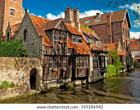 Houses along the canals of Brugge or Bruges, Belgium  - stock photo