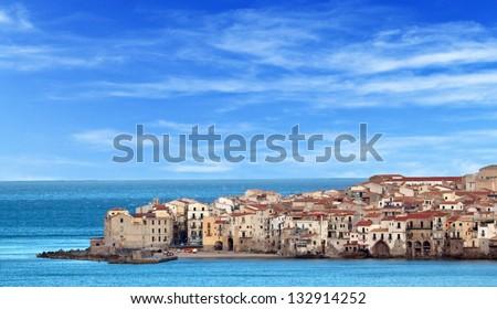 Houses along the shoreline in Cefalu, Sicily - stock photo