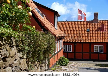 Houses and a danish flag on the island Bornholm.