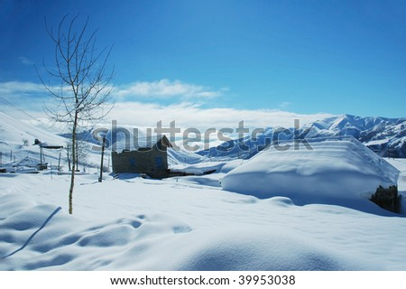 Houses and mountains under snow in winter - Georgia, Gudauri - stock photo