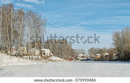 Houses and trees on a frozen pond