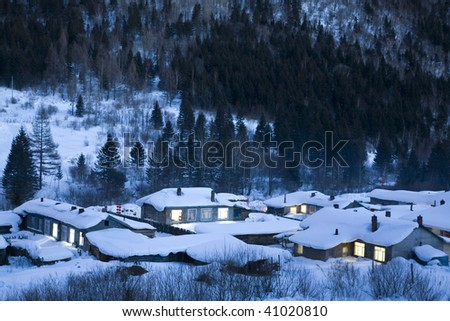 houses are  covered with heavy snow in the evening - stock photo
