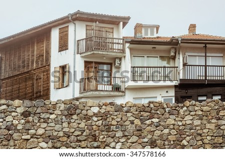 Houses Behind a Stone Wall - stock photo