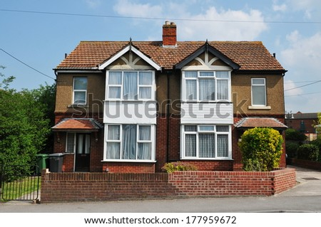 Houses Built Circa 1960 on a Typical English Council Estate Constructed During a Period of Rapid Expansion in Social Housing - stock photo