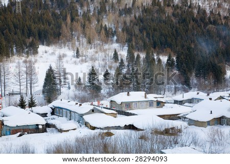 houses covered in snow in winter - stock photo