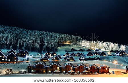Houses decorated and lighted for christmas at night  - stock photo