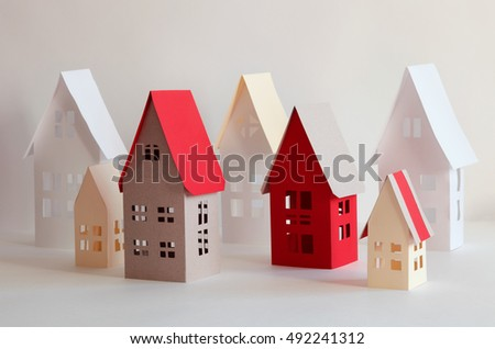 Houses from paper and a color cardboard.