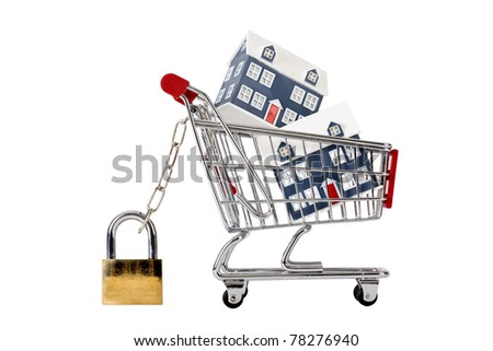 Houses in a trolley secured with chain and padlock - stock photo