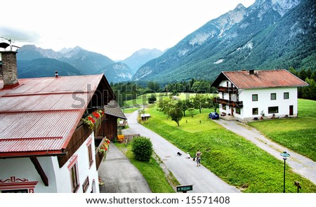 houses in village in mountains alps - stock photo