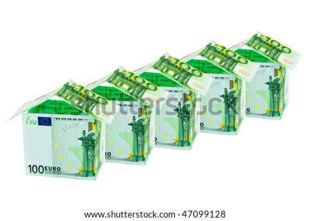 Houses made of money isolated on white background