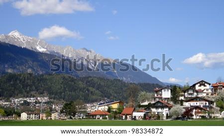 Houses near mountain - stock photo