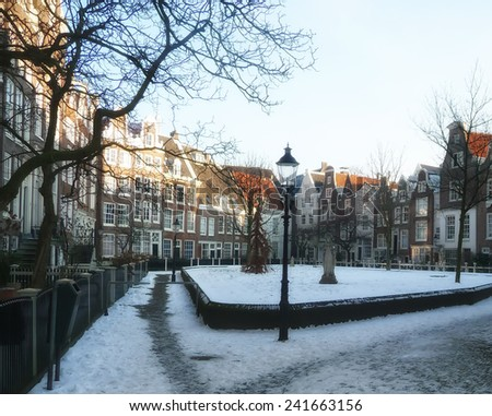 houses of amsterdam in the snow. - stock photo