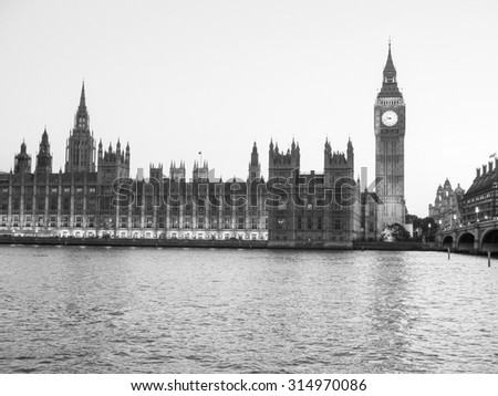 Houses of Parliament aka Westminster Palace at night in London, UK in black and white - stock photo