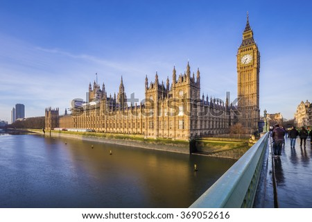 Houses of Parliament and Big Ben with River Thames on an early morning shot in central London, UK - stock photo