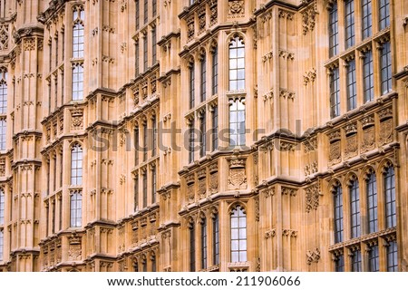 Houses of Parliament, London. Close, full-frame detail of the walls of the UK seat of government, The Houses of Parliament, a classic example of gothic architecture. - stock photo