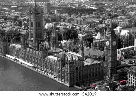Houses of Parliament, London in black & white with London buses highlighted in colour - stock photo