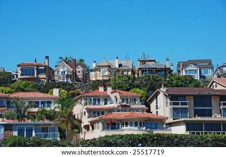 houses on a hill side - stock photo