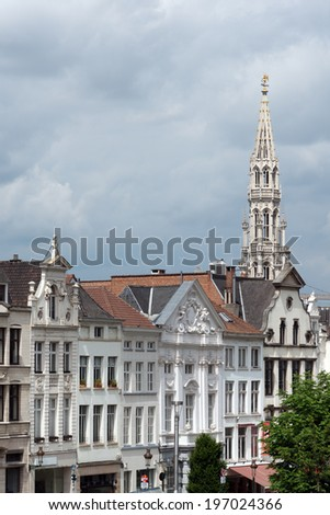 Houses on Albertine square with town hall tower in downtown Brussels