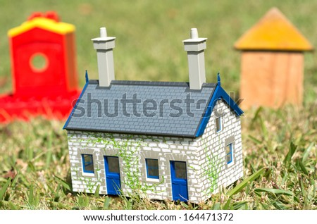 Houses on green grass. Concept photo of Real estate market bubble , booming, money,price, grid, home, rent, house, housing, industry and subprime mortgage crisis. (Copy Space) - stock photo
