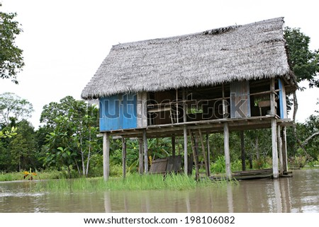Houses on stilts rise above Amazon River Basin near Iquitos, Peru - stock photo