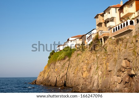 Houses on the cliff above the sea in Sozopol in Bulgaria  - stock photo